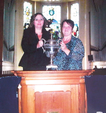 After the Devine Service, Sharon and best friend Jackie Tharby posing with a Russian Samovar which was presented to the Blackpool Spiritualist Church by Emma Hardine Britten on the opening day.